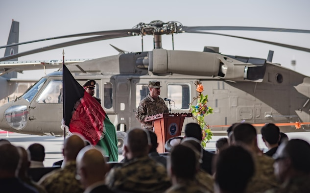 Brig. Gen. Phillip Stewart, commander 438th Air Expeditionary Wing and Train, Advise, Assist Command-Air, speaks in front of the first Afghan UH-60 Black Hawk during a ribbon cutting ceremony Oct. 7, 2017, at Kandahar Airfield, Afghanistan. Stewart said the UH-60 will be an important step in the modernization of the Afghan Air Force, which is slated to double in size in the coming years. (U.S. Air Force photo by Staff Sgt. Alexander W. Riedel)