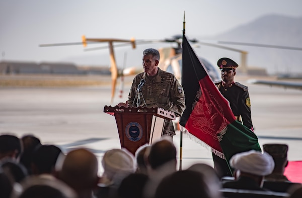 Army Gen. John W. Nicholson, commander of the Resolute Support mission and U.S. Forces − Afghanistan, speaks during the official UH-60 Black Hawk transfer ceremony, Oct. 7, 2017, at Kandahar Airfield, Afghanistan. Nicholson and Afghanistan President Ashraf Ghani performed a ceremonial ribbon cutting celebrating the newest addition to Afghanistan's young air force fleet while vowing continued commitment to the fight against the anti-government insurgency in Afghanistan. (U.S. Air Force photo by Staff Sgt. Alexander W. Riedel)