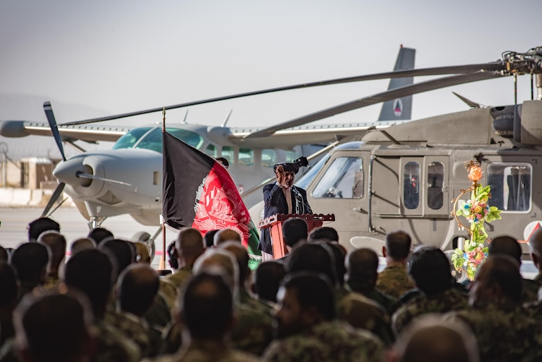 Afghanistan President Ashraf Ghani speaks during the official UH-60 Black Hawk arrival ceremony, Oct. 7, 2017, at Kandahar Airfield, Afghanistan. Ghani and U.S. Army Gen. John W. Nicholson, commander of the Resolute Support Mission and U.S. Forces − Afghanistan, performed a ceremonial ribbon cutting celebrating the newest addition to Afghanistan's young air force fleet while vowing continued commitment to the fight against the anti-government insurgency in Afghanistan. (U.S. Air Force photo by Staff Sgt. Alexander W. Riedel)