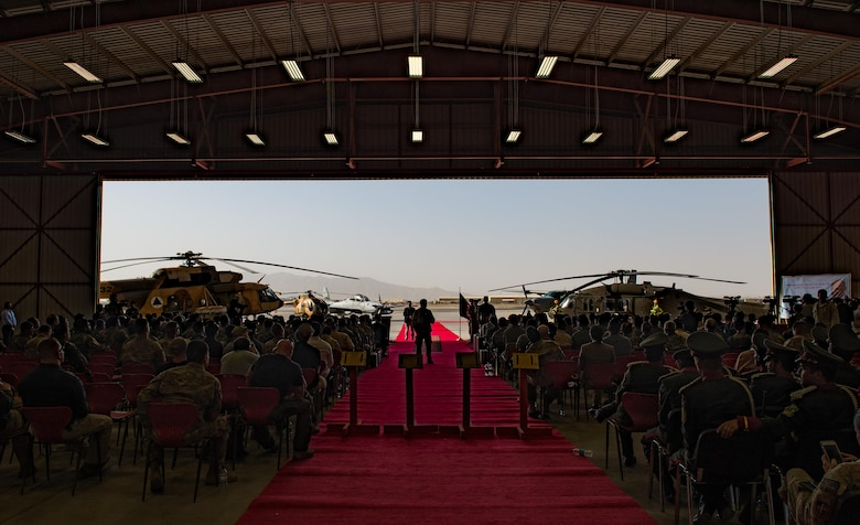 Afghanistan President Ashraf Ghani speaks during the official UH-60 Black Hawk arrival ceremony, Oct. 7, 2017, at Kandahar Airfield, Afghanistan. Ghani and U.S. Army Gen. John W. Nicholson, commander of the Resolute Support mission and U.S. Forces − Afghanistan, performed a ceremonial ribbon cutting celebrating the newest addition to Afghanistan's air force fleet, while vowing continued commitment to the fight against the anti-government insurgency in Afghanistan. (U.S. Air Force photo by Staff Sgt. Alexander W. Riedel)