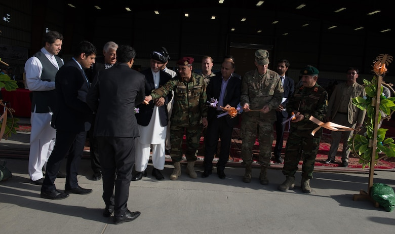 Senior Afghan government officials and coalition defense leaders share in a ribbon cutting symbolizing the transfer of ownership of the first UH-60 Black Hawk helicopter to the Afghan Air Force Oct. 7, 2017, at Kandahar Airfield, Afghanistan. The UH-60 has been selected to enhance the AAF helicopter fleet and augment the capabilities currently provided by the Mi-17 legacy platform. (U.S. Air Force photo by Staff Sgt. Alexander W. Riedel)