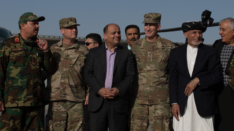 From right, Afghan President Ashraf Ghani, U.S. Army Gen. John W. Nicholson, commander of the Resolute Support mission and U.S. Forces − Afghanistan, Unknown, U.S. Air Force Brig. Gen. Phillip Stewart and Maj. Gen. Mohammad Shoaib, stand for a photo after the UH-60 Black Hawk arrival ceremony Oct. 7, 2017, at Kandahar Airfield, Afghanistan. The officials performed a ribbon cutting and ceremonial signing of transfer certificates, celebrating the transfer of ownership of the first delivery of UH-60s to the Afghan Air Force. Stewart is the commander 438th Air Expeditionary Wing and Train, Advise, Assist Command-Air and Shoaib is the Afghan Air Force commander. (U.S. Air Force photo by Staff Sgt. Alexander W. Riedel)