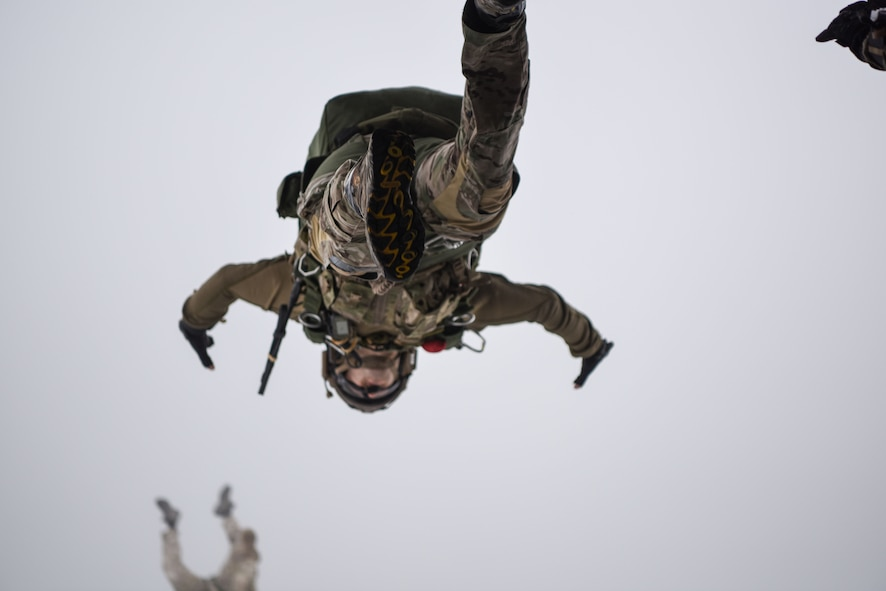 Airmen with the 321st Special Tactics Squadron, 352 Special Operations Wing execute a military free fall jump out of an MC-130J Commando II over southern England, 29 Sept. 2017. The air commandos performed this jump as maintain jump proficiency while ensuring readiness to execute global special operations at a moment's notice.