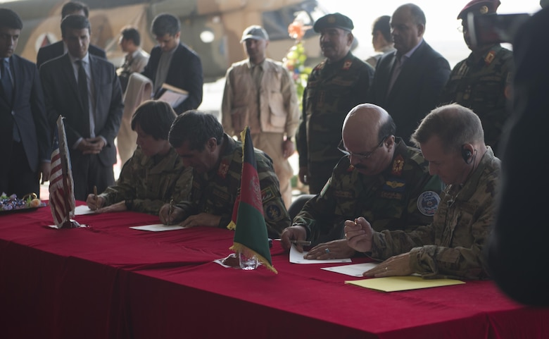 U.S. and Afghan military leaders sign certificates officially transferring the UH-60 Black Hawk helicopters from the U.S. military to the Afghan Air Force during a ceremony Oct. 7, 2017, at Kandahar Airfield, Afghanistan. The AAF received Black Hawks from the U.S. to bolster their air power capabilities. The helicopters provide sustainable, capable replacements for aging aircraft currently in use. (U.S. Air Force photo by Staff Sgt. Benjamin Gonsier)