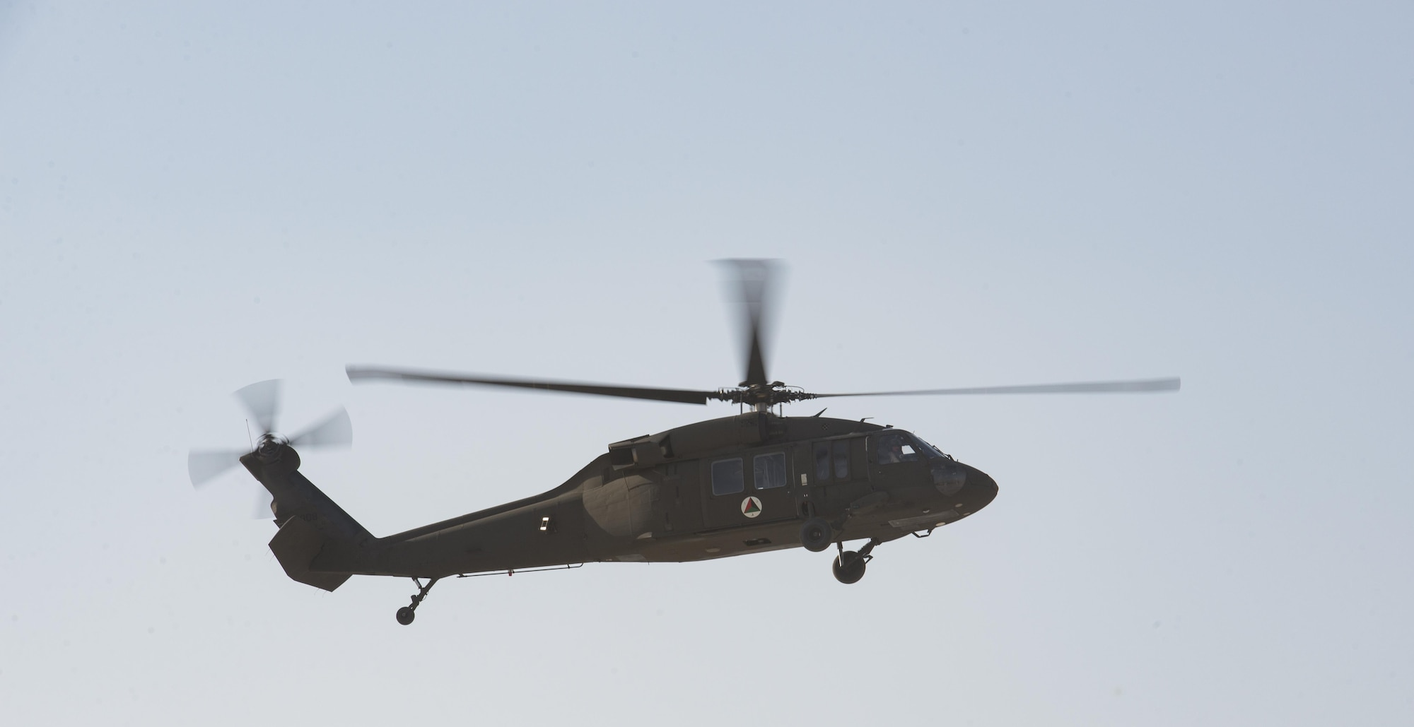 An Afghan Air Force UH-60 Black Hawk helicopter hovers over Kandahar Airfield, Afghanistan, Oct. 7, 2017. The AAF received the first two Black Hawks from the U.S. to bolster their air operations capabilities. The helicopters provide sustainable, capable replacements for aircraft currently in use. The UH-60s will help the AAF and Afghan National Defense and Security Forces combat insurgent groups. (U.S. Air Force photo by Staff Sgt. Benjamin Gonsier)