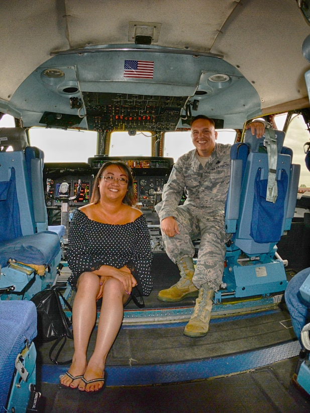 Karen Keshura, Babylift crash survivior, poses for a photo with Chief Master Sgt. Justin Thurber in the cockpit of C-5A Galaxy 0461, the Air Force's final C-5A that recently was retired.