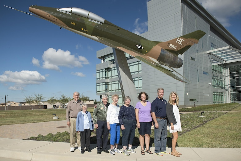 Retired Air Force Major Norman Schaap, (third from the left) stopped by the Air National Guard Readiness Center at Joint Base Andrews, Maryland, October 2, 2017, to visit the F-100 Super Sabre aircraft he once piloted. Schaap delivered the fighter to the boneyard at Davis-Monthan Air Force Base, Arizona. The Super Sabre was an American supersonic jet fighter aircraft that served with the USAF from 1954 to 1971 and with the ANG until 1979. (U.S. Air National Guard photo by Master Sgt. Marvin R. Preston)