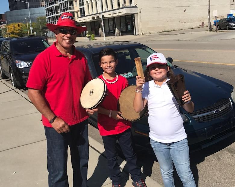 DAYTON, Ohio - Miguel Maldonado, Air Force Research Laboratory Fuels and Energy branch chief, poses with his grandchildren prior to performing at the 7th Annual Hispanic Heritage Festival & Parade in Dayton, Ohio Sept.16, 2017. Maldonado said he believes that mentoring, both cultural and profession, is everyone's responsibility, but especially for those who have seen success in life. (Courtesy photo/Miguel Maldonado)