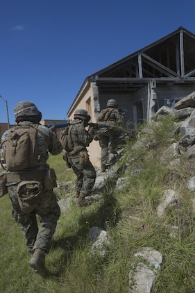 Marines with 2nd Battalion, 8th Marine Regiment enter a building during a military operation on urbanized terrain exercise at Camp Lejeune, N.C., Oct. 3, 2017. The Marines conducted MOUT training in preparation for their upcoming deployment to Japan. (U.S. Marine Corps photo by Lance Cpl. Ashley McLaughlin)
