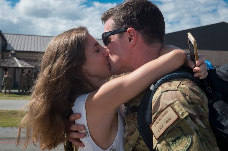 Capt. Evan Aldinger, 71st Rescue Squadron (RQS) HC-130J Combat King II pilot, embraces his wife, Allison, during a redeployment, Oct. 6, 2017, at Moody Air Force Base, Ga. Airmen from the 71st RQS supported deployed operations by providing expeditionary personnel with on-call recovery forces should they need to be rescued. (U.S. Air Force photo by Senior Airman Greg Nash)