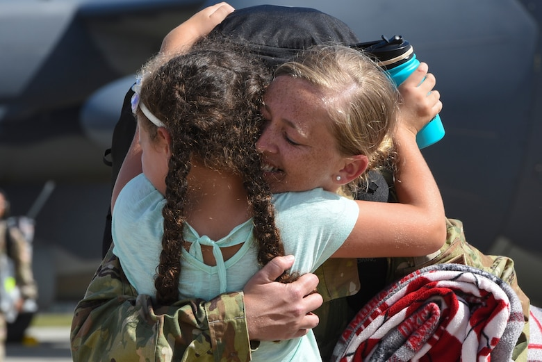 Master Sgt. Danielle Bruce-Salmon, 71st Rescue Squadron (RQS) special aviation resource management superintendent, hugs her daughter, Brooklyn, during a redeployment, Oct. 6, 2017, at Moody Air Force Base, Ga. Airmen from the 71st RQS supported deployed operations by providing expeditionary personnel with on-call recovery forces should they need to be rescued. (U.S. Air Force photo by Senior Airman Greg Nash)