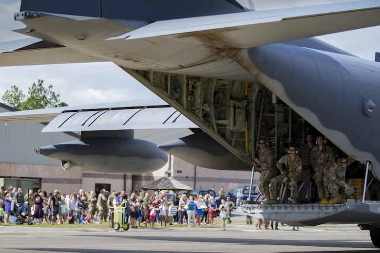 A 71st Squadron (RQS) HC-130J Combat King II taxis while Airmen and families wait to greet loved ones during a redeployment, Oct. 6, 2017, at Moody Air Force Base, Ga. Airmen from the 71st RQS supported deployed operations by providing expeditionary personnel with on-call recovery forces should they need rescued. (U.S. Air Force photo by Airman 1st Class Daniel Snider)