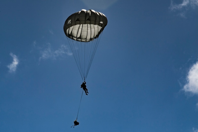 A member of the 820th Base Defense Group descends during a static-line jump, Oct. 3, 2017, at the Lee Fulp drop zone in Tifton, Ga. During a static-line jump, the jumper is attached to the aircraft via the 'static-line', which automatically deploys the jumpers' parachute after they've exited the aircraft.(U.S. Air Force photo by Airman 1st Class Daniel Snider)