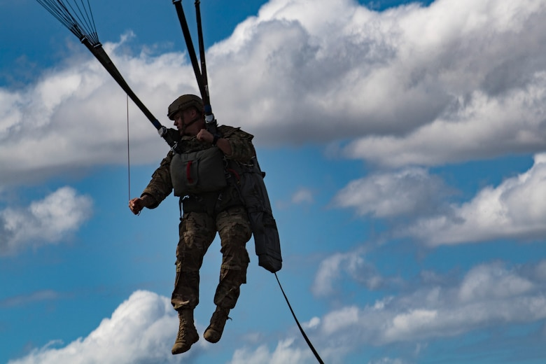 A member of the 820th Base Defense Group descends during a static-line jump, Oct. 3, 2017, at the Lee Fulp drop zone in Tifton, Ga. During a static-line jump, the jumper is attached to the aircraft via the 'static-line', which automatically deploys the jumpers' parachute after they've exited the aircraft. (U.S. Air Force photo by Airman 1st Class Daniel Snider)