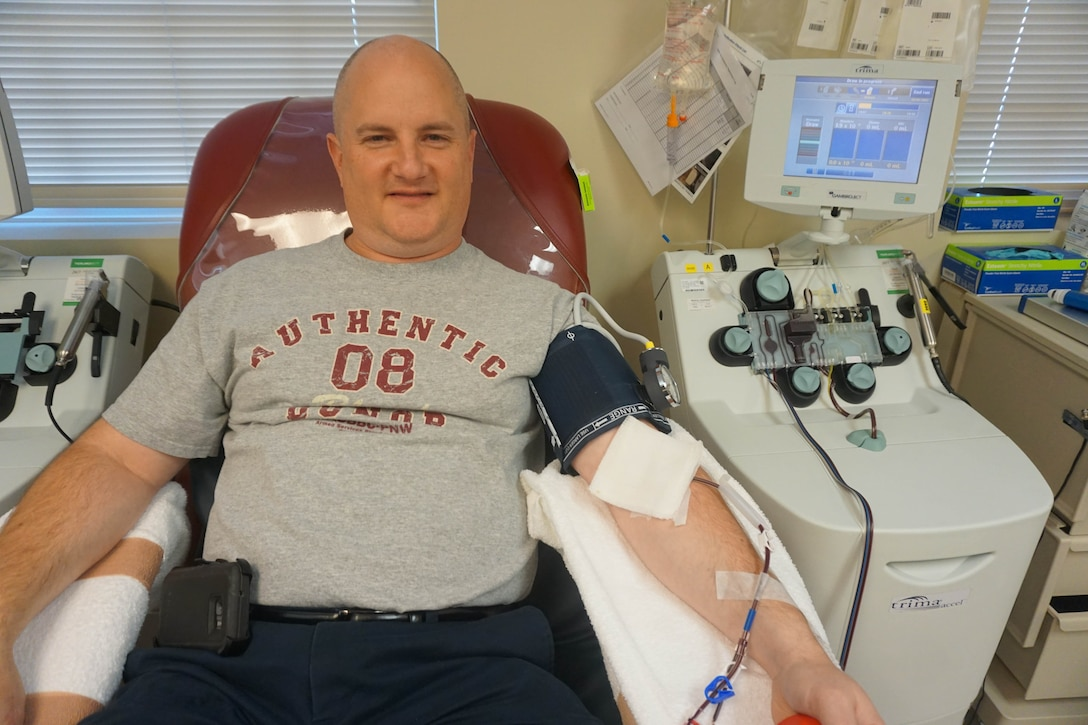Aaron Boone, finance specialist for the Western Air Defense Sector, donates blood platelets Oct. 5 at the Armed Services Blood Bank Center Pacific Northwest.  He was named an American Red Cross Hometown Hero for donating blood platelets 26 times over a 15-month period. (Photo Courtesy of Aaron Boone)