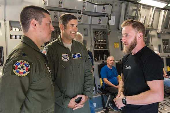 Lt. Cols. Paul DeFlorio, 436th Aerospace Medicine Squadron commander, and Ryan Orfe, 3d Airlift Squadron pilot and special projects officer, talk with Jeffrey Earnhardt, Monster Energy NASCAR Cup Series driver, in the cargo compartment of a C-17 Globemaster III Sept. 29, 2017, on Dover Air Force Base, Del. During the NASCAR orientation flight, Earnhardt observed the C-17 being refueled by KC-135T Stratotankers from the 127th Wing, Selfridge Air National Guard Base, Mich. (U.S. Air Force photo by Roland Balik)