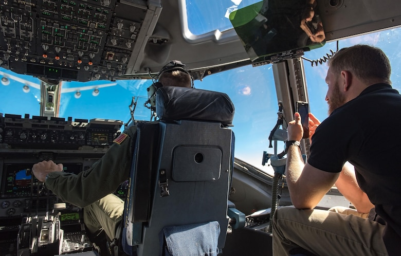 Jeffrey Earnhardt, Monster Energy NASCAR Cup Series driver, observes and records 3d Airlift Squadron pilots flying a C-17 Globemaster III into position for air refueling Sept. 28, 2017, out of Dover Air Force Base, Del. Earnhardt observed the Globemaster III being refueled by KC-135T Stratotankers from the 127th Wing, Selfridge Air National Guard Base, Mich. (U.S. Air Force photo by Roland Balik)