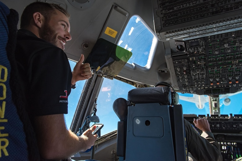 Ross Chastain, NASCAR Xfinity Series driver, observes and records 3d Airlift Squadron pilots flying a C-17 Globemaster III into position for air refueling Sept. 28, 2017, out of Dover Air Force Base, Del. Chastain observed the Globemaster III being refueled by KC-135T Stratotankers from the 127th Wing, Selfridge Air National Guard Base, Mich. (U.S. Air Force photo by Roland Balik)