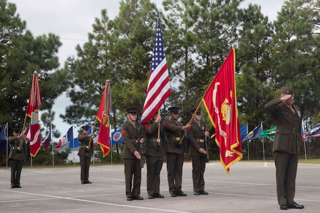 Marines salute the colors during an anniversary ceremony at Camp Lejeune, N.C., Oct. 6, 2017. Marines of past and present gathered to commemorate the 100th anniversary of the inception of 8th Marine Regiment. The unit was established Oct. 9, 1917. (U.S. Marine Corps photo by Pfc. Nicholas Guevara)