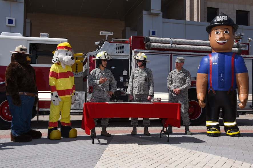 U.S. Air Force Col. Ricky Mills, 17th Training Wing commander, speaks to the crowd before signing the Fire Week Prevention proclamation at the Norma Brown Building on Goodfellow Air Force Base Oct. 5, 2017. With the help of Smokey, Spark and Blaze, the importance of knowing multiple ways out of each building and the importance of Fire Prevention Week was addressed by Mills. (U.S. Air Force photo by Airman Zachary Chapman/Released)