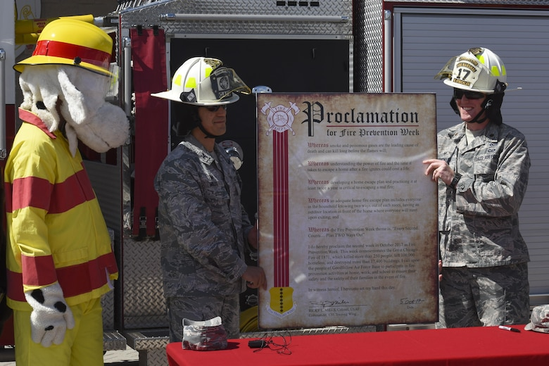 "U.S. Air Force Col. Ricky Mills, 17th Training Wing commander, and Maj Matthew Strickler, 17th Civil Engineer Squadron commander, pose with the signed Fire Week Prevention proclamation at the Norma Brown Building on Goodfellow Air Base, Texas Oct. 5, 2017. The signing brought awareness to the Fire Prevention Week and its theme of ""Every Second Counts: Plan Two Ways Out."" (U.S. Air Force photo by Airman Zachary Chapman/Released)"