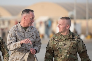 Joint Chiefs chairman talks with his senior enlisted advisor.