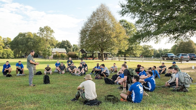 "U.S. Army Master Sgt. Todd Fetzer, 1st Special Forces Command (Airborne), Ft. Bragg, N.C., tells the history of GORUCK to event participants Oct. 6, 2017, at Brecknock Park in Camden, Del. Fetzer, also known by his GORUCK nickname ""Fury,"" was the cadre for the 2017 GORUCK Light Challenge. (U.S. Air Force photo by Roland Balik)"
