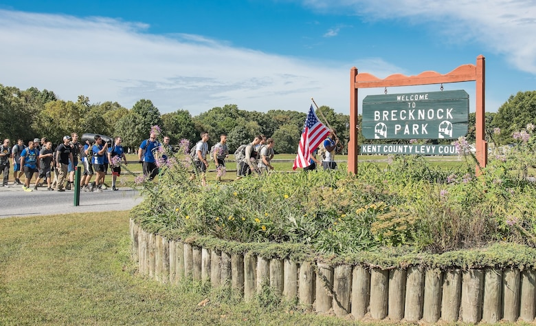 Participants in the 2017 GORUCK Light Challenge begin the first of three laps on the hiking trail Oct. 6, 2017, at Brecknock Park in Camden, Del. The hike was the last challenge of the day. (U.S. Air Force photo by Roland Balik)