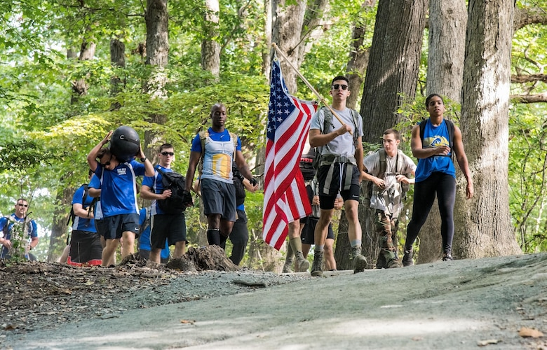 Participants in the 2017 GORUCK Light Challenge make their way around the hiking trail Oct. 6, 2017, at Brecknock Park in Camden, Del. Participants completed three laps while carrying their rucksack, chains and a punching bag. (U.S. Air Force photo by Roland Balik)