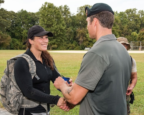 Brittany Bailey, 436th Logistics Readiness Squadron vehicle mechanic, receives her 2017 GORUCK Light patch from U.S. Army Master Sgt. Todd Fetzer, 1st Special Forces Command (Airborne), Ft. Bragg, N.C., Oct. 6, 2017, at Brecknock Park in Camden, Del. Bailey was one of 29 individuals who completed the GORUCK Challenge. (U.S. Air Force photo by Roland Balik)