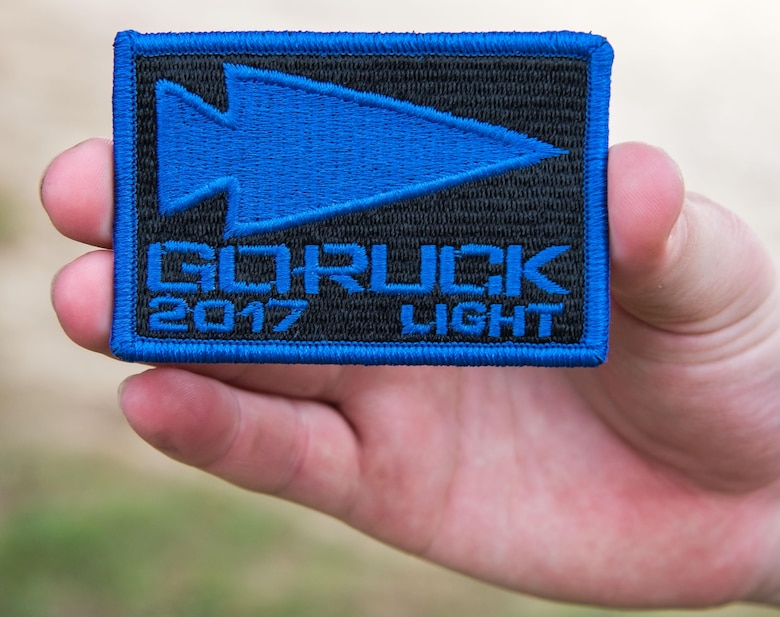 Autumn Anderson, 436th Maintenance Squadron aerospace maintenance apprentice, holds her 2017 GORUCK Light Challenge patch, Oct. 6, 2017, at Brecknock Park in Camden, Del. Anderson was one of 29 individuals who completed the five-hour GORUCK Challenge. (U.S. Air Force photo by Roland Balik)