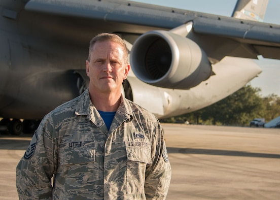 Master Sgt. D.J. Little, a 94th Maintenance Squadron hydraulic technician, poses for a photo in front of a C-5M Super Galaxy at Dobbins Air Reserve Base, Ga. Oct. 6, 2017. Little worked alongside technicians from Dover Air Force Base, Dela. to create custom hydraulic hoses to bypass a faulty actuator to make the necessary repairs so the plane could take communication equipment to Puerto Rico. (U.S. Air Force photo/Staff Sgt. Andrew Park)