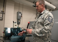 Master Sgt. D.J. Little, a 94th Maintenance Squadron hydraulic technician, demonstrates the tool he used to cut hydraulic hoses for a C-5M Super Galaxy at Dobbins Air Reserve Base, Ga. Oct. 6, 2017. The hoses were used to bypass a faulty actuator that prevented the visor of the aircraft from opening so that vital communication could be offloaded in Puerto Rico. (U.S. Air Force photo/Staff Sgt. Andrew Park)