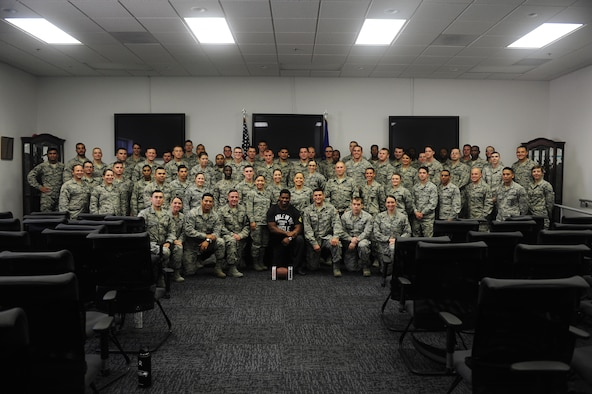Herschel Walker, former NFL running back and Patriot Support Program spokesman, poses for a group  photo with Airman Leadership School Class 18-A during a visit to Davis-Monthan Air Force Base, Ariz., Oct. 4, 2017. Walker visited the installation to share his personal experience with mental illness and treatment as a spokesman for Patriot Support Program's Anti-Stigma Campaign. (U.S. Air Force photo by Senior Airman Betty Chevalier)