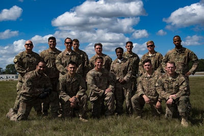 Members of the 820th Base Defense Group pose with Tech. Sgt. Joe Ostrum, 820th Combat Operations Squadron personal parachute program manager, front, third from the left, after he earned his senior-rated parachutist badge during a static-line jump, Oct. 3, 2017, at the Lee Fulp drop zone in Tifton, Ga. During a static-line jump, the jumper is attached to the aircraft via the 'static-line', which automatically deploys the jumpers' parachute after they've exited the aircraft. (U.S. Air Force photo by Airman 1st Class Daniel Snider)