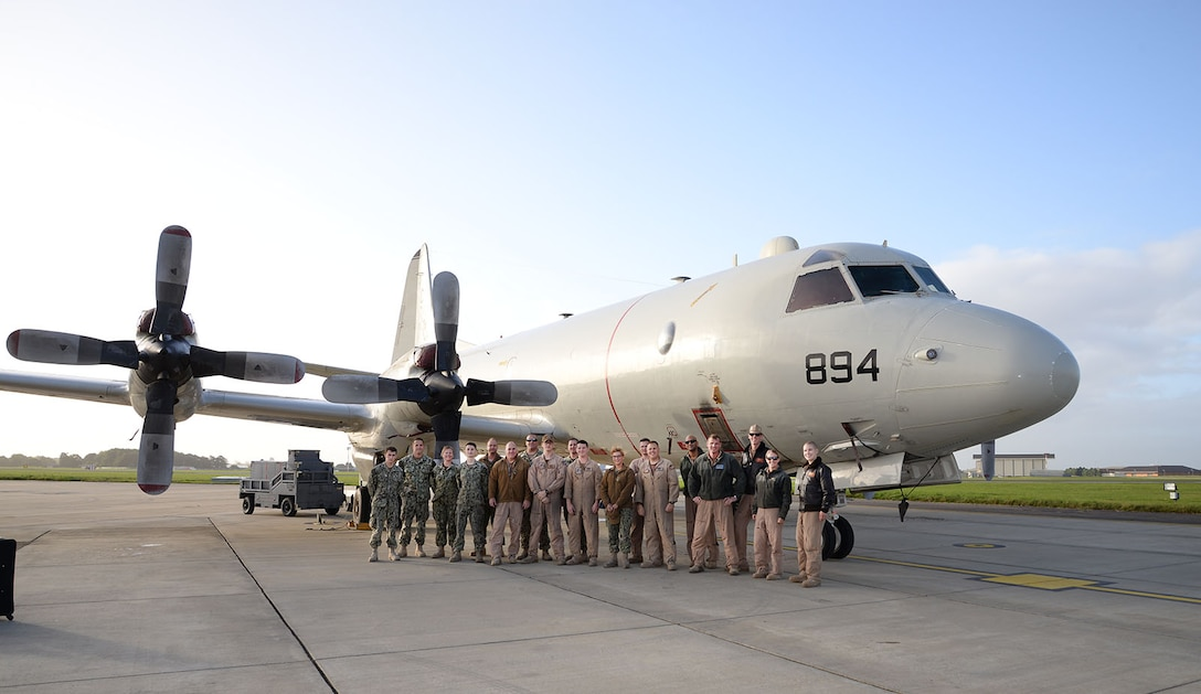 Crew from a U.S. Navy P-3C Orion aircraft pose for a photo before preparing their aircraft for the journey home to Naval Air Station Whidbey Island, Wash., Oct. 2, 2017, on RAF Mildenhall, England. The VP-46 Grey Knights, Naval Air Station Whidbey Island, Wash., were returning from a six-month deployment in support of U.S. Central Command operations and are now on their way home. (U.S. Air Force photos by Karen Abeyasekere)