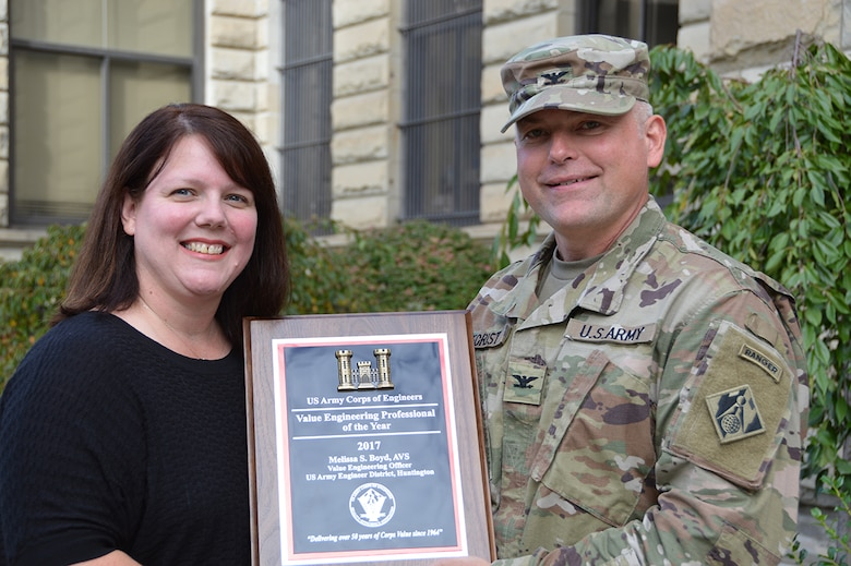 Colonel Secrist presents Melissa Boyd with her award of the USACE Value Engineer of the Year for 2017.