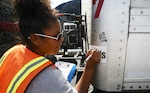 Veronica Robinson, a Defense Logistics Agency distribution process worker, makes an identification mark on a sticker labeled MREs, at JBSA Randolph auxiliary airfield, Seguin, Texas, August 30, 2017.  Robinson, from Harrisburg, Pennsylvania, logs in all tractor trailers entering the receiving station and identifies their staging location on the airfield.