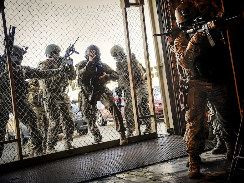The 791st Missile Security Forces Squadron tactical response force members enter a facility at Minot Air Force Base, N.D., Oct. 14, 2015.