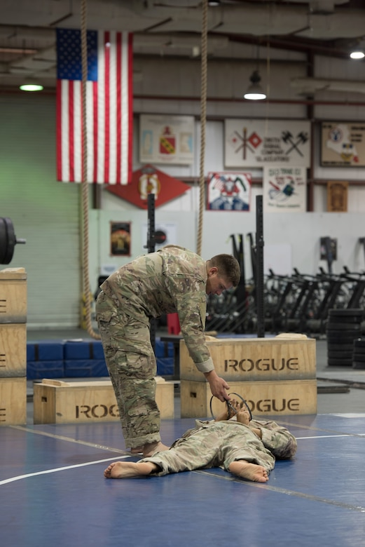 Soldiers practicing hand-to-hand combat.