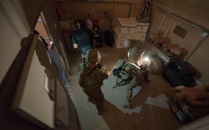 Soldiers go through a room-clearing exercise.