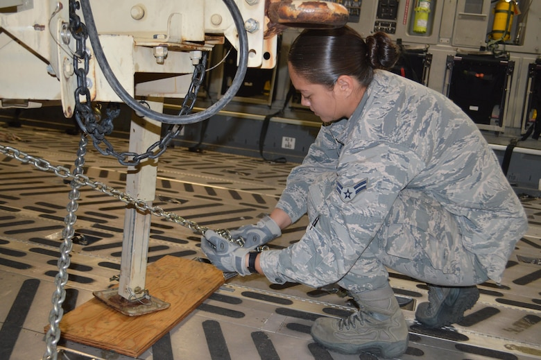 Airman 1st Class Erica Barnes, aerial port airman, 21st Logistics Readiness Squadron, ties down a general-purpose trailer in a C-17 Globemaster III aircraft Sept. 29 at the Fort Carson Arrival/Departure Air Control Group. Approximately 150 Fort Carson 4th Sustainment Brigade, 4th Infantry Division Soldiers deployed to Puerto Rico and the Virgin Islands to support Federal Emergency Management Agency and relief operations on the island after it was devastated by Hurricane Maria. (U.S. Army photo by Dani Johnson)