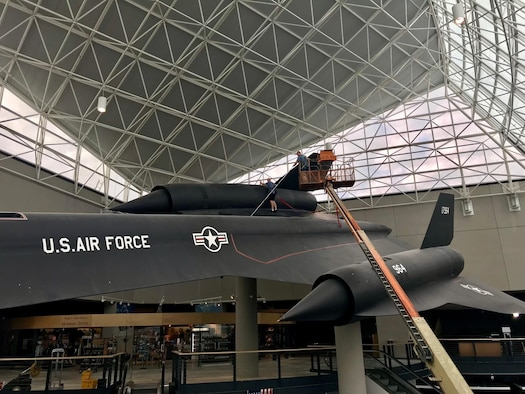 Airmen from the 820th Intelligence Squadron, Offutt Air Force Base, Nebraska, clean an SR-71 Blackbird Oct. 3, 2017 on display at the Strategic Air Command Aerospace Museum, Ashland, Nebraska.