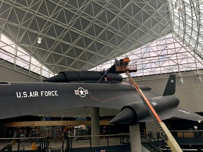 Airmen from the 820th Intelligence Squadron, Offutt Air Force Base, Nebraska, clean an SR-71 Blackbird Oct. 3, 2017 on display at the Strategic Air Command Aerospace Museum, Ashland, Nebraska.