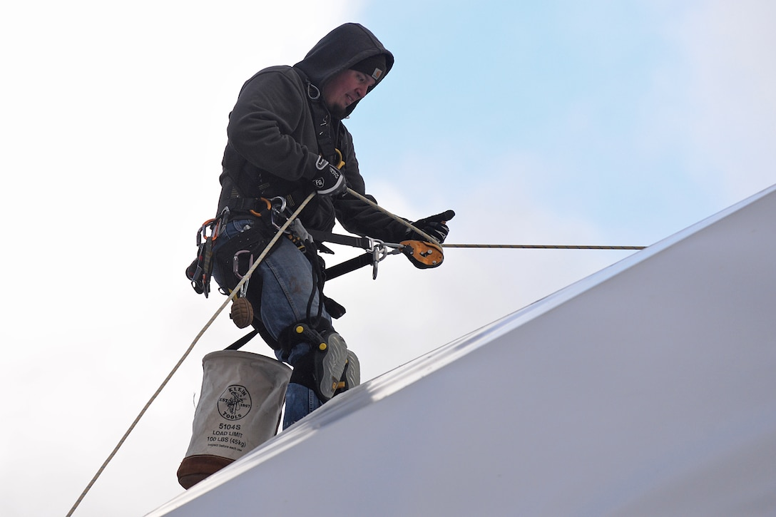 Justin Cevering, 526th Electronics Maintenance Squadron plastic fabricator inspector, uses a newly installed rope to repel down the side of a satellite communications radome at Cape Romanzof, Alaska, on Sep. 27, 2017. Ropes are secured to the tops of the radomes and allow inspectors to climb onto radome exteriors to perform maintenance.  (U.S. Air Force photo by Alex R. Lloyd)