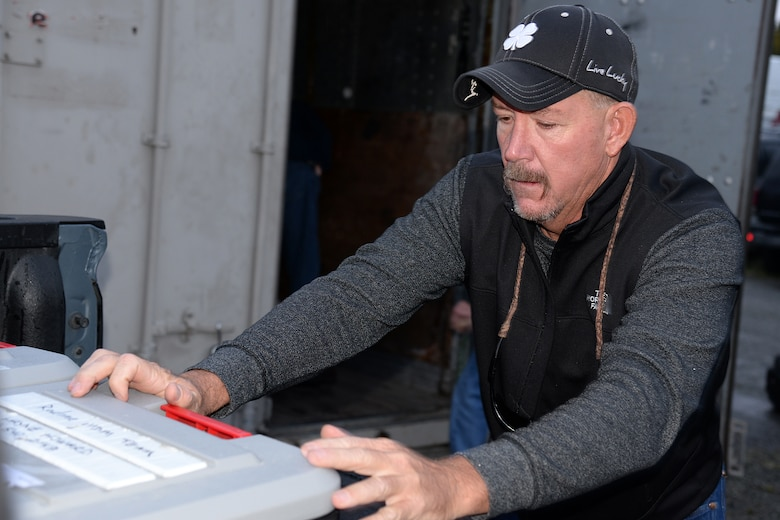 Jim Egbert, 526th Electronics Maintenance Squadron plastic fabricator inspector, loads a large container of supplies on Sep. 25, 2017 in Anchorage, Alaska, into the bed of a pickup truck. This container and other equipment, are prepositioned in a local storage unit to ensure they are available when needed and can be transported to any site in Alaska. . (U.S. Air Force photo by Alex R. Lloyd)