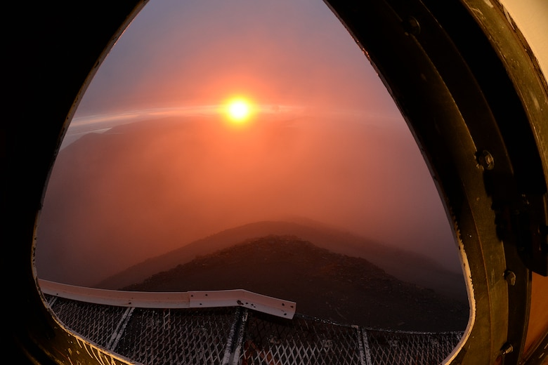 At Cape Romanzof, Alaska, depot field tream members start their day early inside the LRRS radome, on Sep. 26, 2017. The weather breaks long enough to view a beautiful sunrise over the Alaska interior. (U.S. Air Force photo by Alex R. Lloyd)