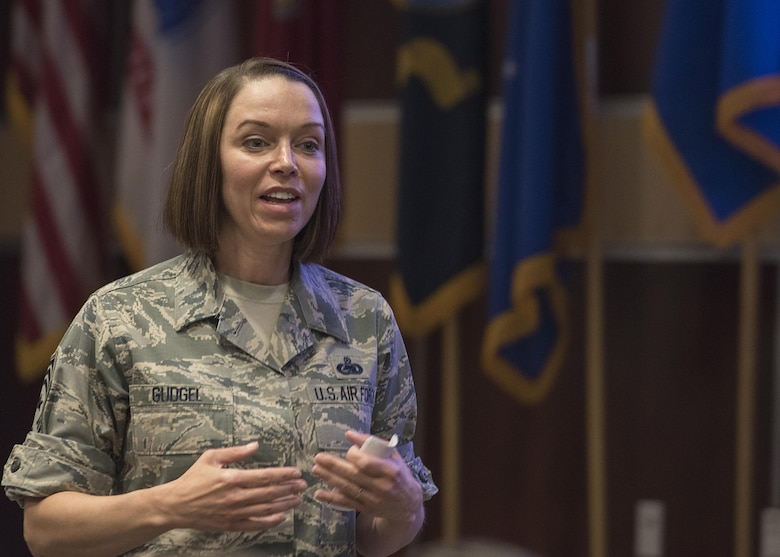 U.S. Air Force Chief Master Sgt. Juliet Gudgel, Air Education and Training Command command chief, speaks with members of the 33rd Fighter Wing during a senior leadership all-call Oct. 3, 2017, at Eglin Air Force Base, Fla. During Gudgel's first visit, she introduced herself to wing leadership and discussed the roles that each leader should take to promote change at their level. (U.S. Air Force photo by Staff Sgt. Peter Thompson)