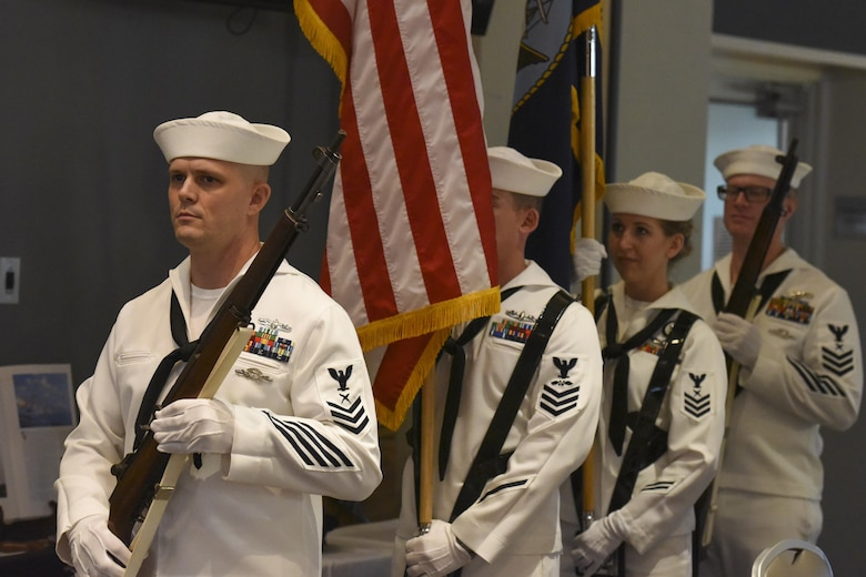 U.S. Navy color guard stand by for the start of the Navy Ball at the Event Center on Goodfellow Air Force Base, Texas Oct. 6, 2017. The evening ceremonies began with the posting of colors by the color guard and the setting of the POW/MIA table. (U.S. Air Force photo by Airman Zachary Chapman/Released)