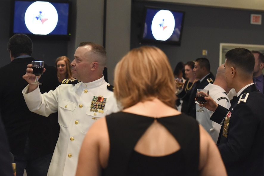 U.S. Navy Lt. Cmdr. Christopher Allen, Center for Information Warfare Training Detachment Goodfellow officer in charge, joins the traditional toast and response at the Navy Ball on Goodfellow Air Force Base, Texas Oct. 6, 2017. The toast pays respect to the President of the United States, the Secretary of Defense, and to all of the armed forces. (U.S. Air Force photo by Airman Zachary Chapman/Released)